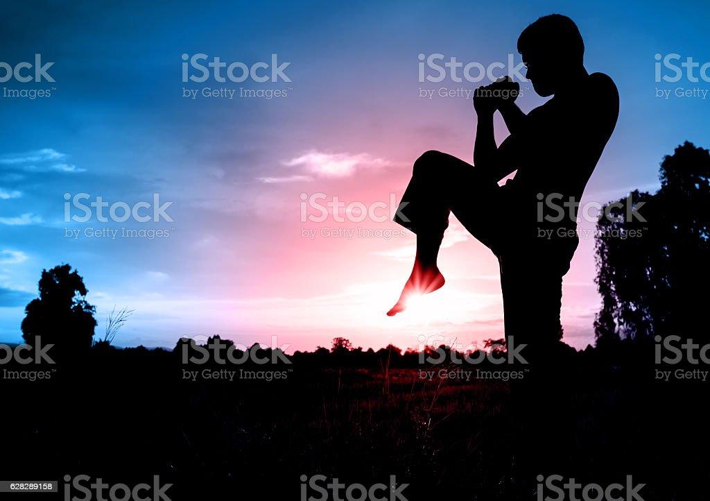 Muaythai, Thai Boxer in sunset background stock photo