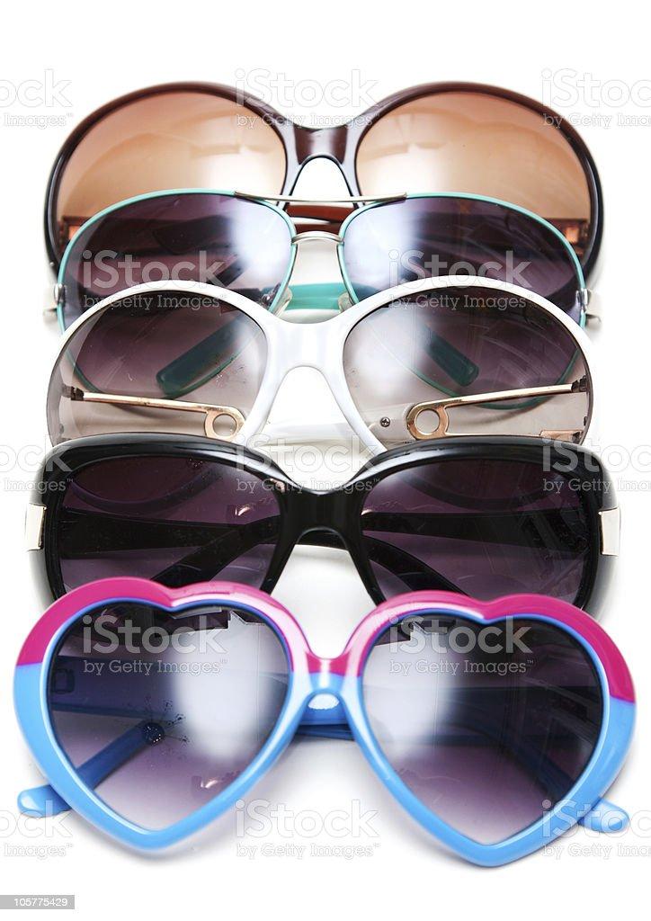 Much sunglasseses put in row stock photo