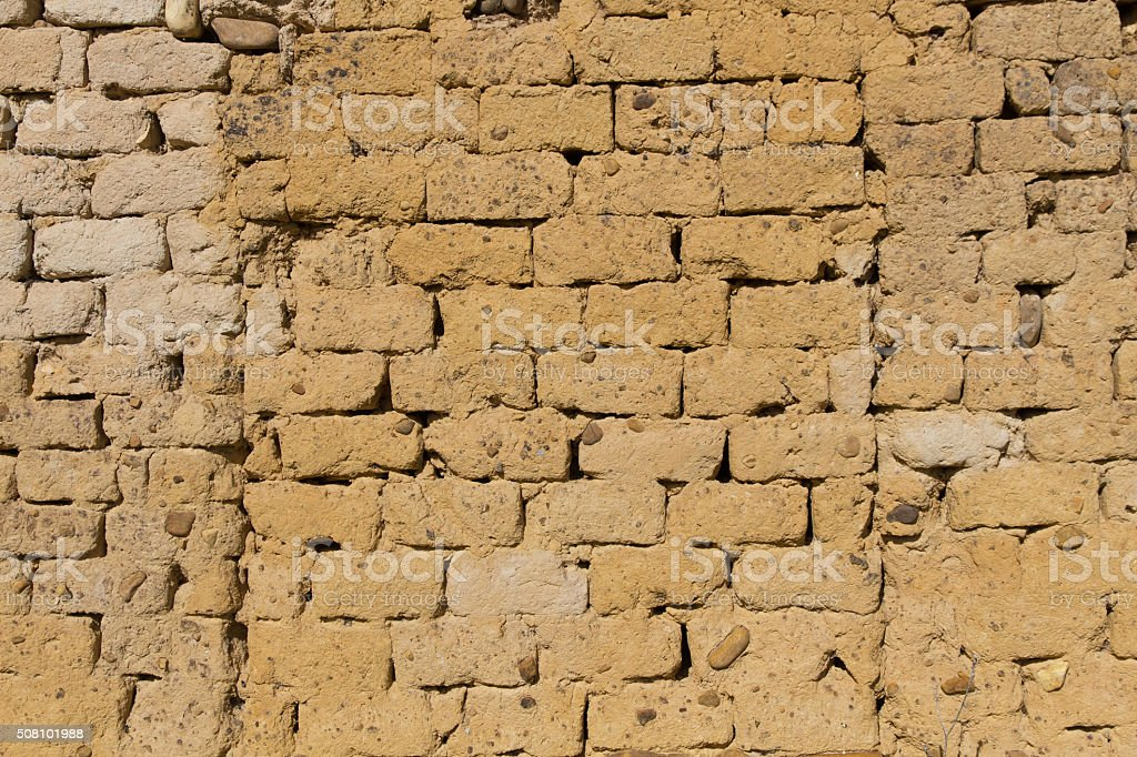 Mud Adobe Wall Texture - Textura de pared barro adobe stock photo