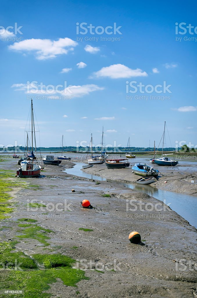 Mud at low tide in Holbrook Creek, Suffolk stock photo
