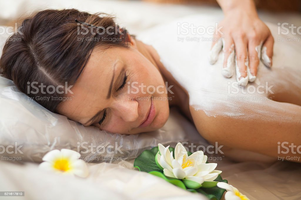 Mud beauty treatment stock photo