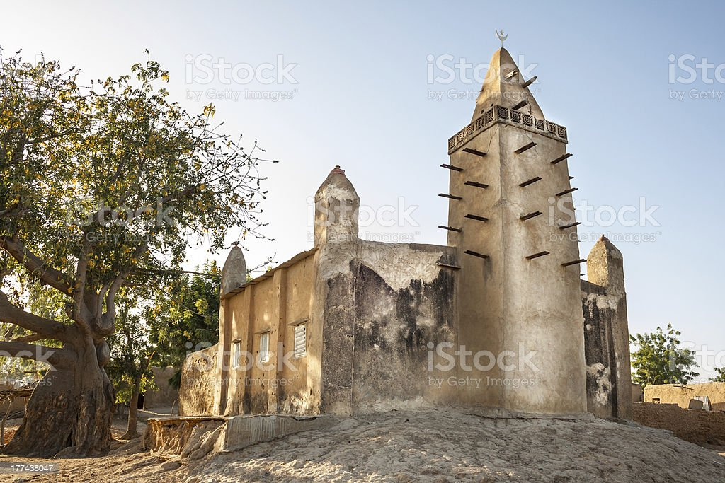 Mud brick mosque in a small village, Mali, Africa. stock photo