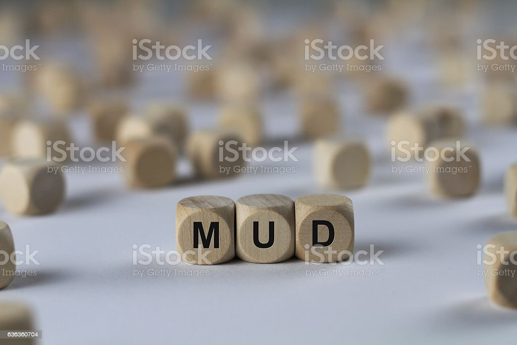mud - cube with letters, sign with wooden cubes stock photo