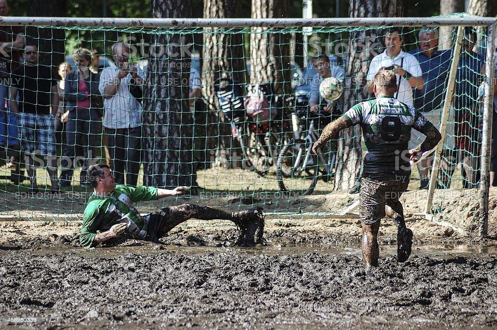 Mud football goal stock photo