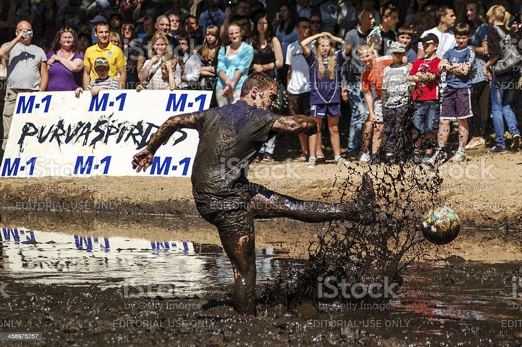 Mud football player stock photo