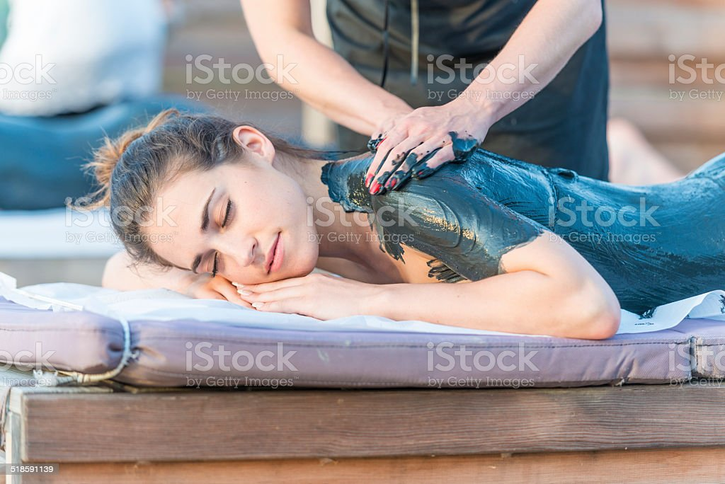 Mud massage stock photo