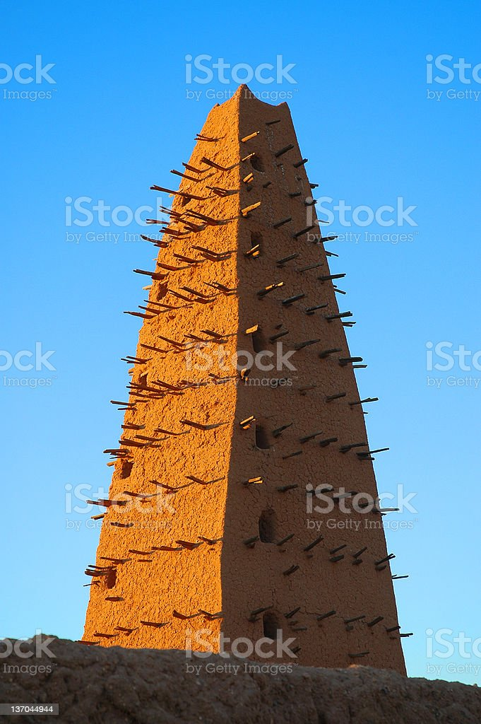 Mud mosque minaret in Agadez royalty-free stock photo
