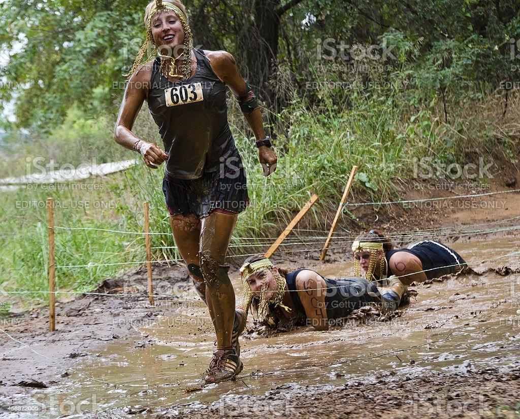 Mud run participants wearing costumes royalty-free stock photo