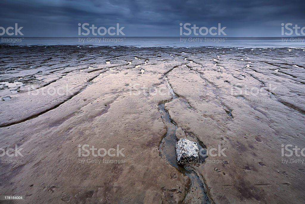 mud texture at low tide on North sea stock photo