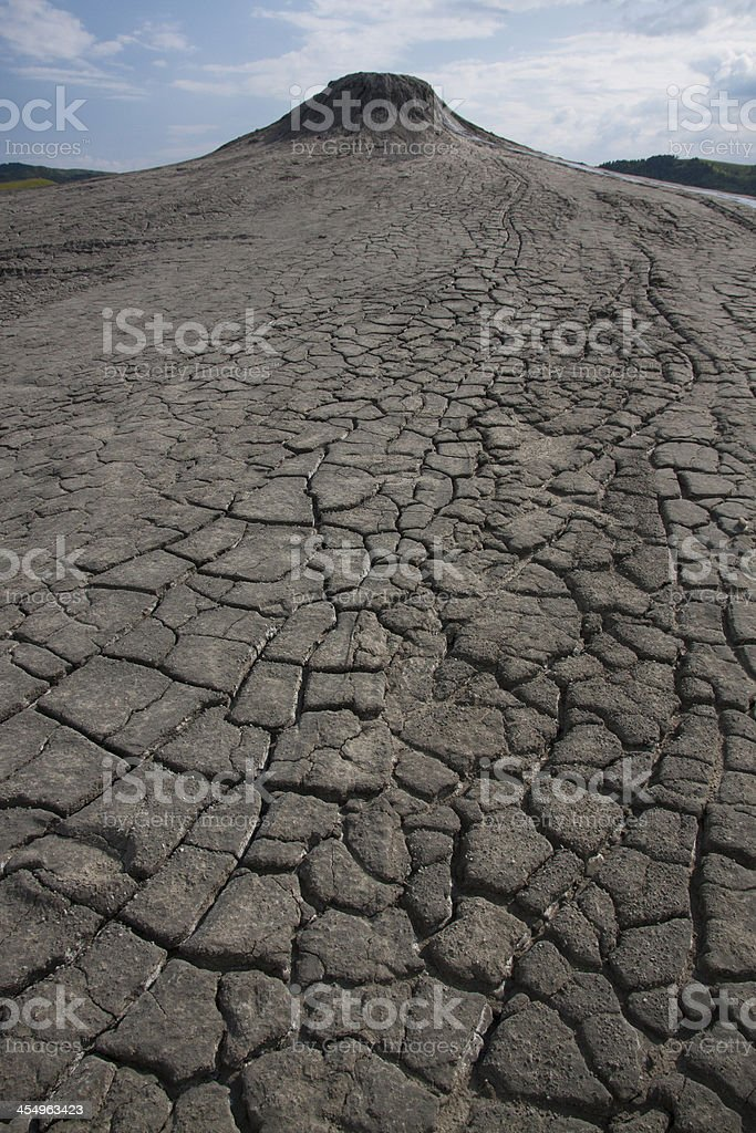 Mud volcano and cracked soil stock photo