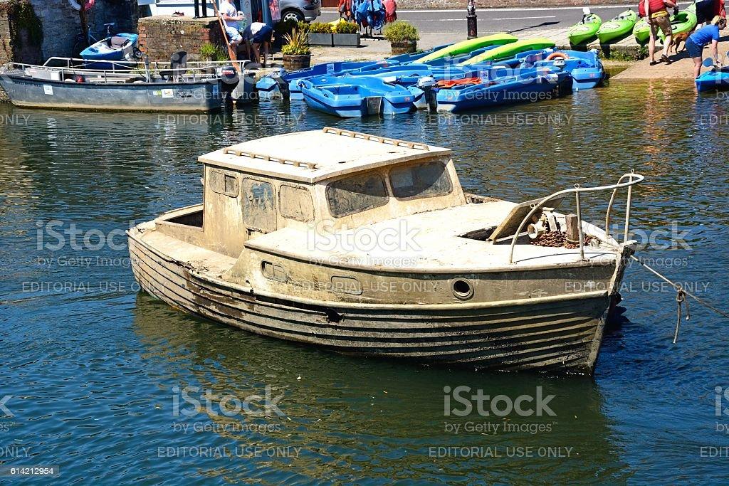 Muddy boat on river, Wareham. stock photo