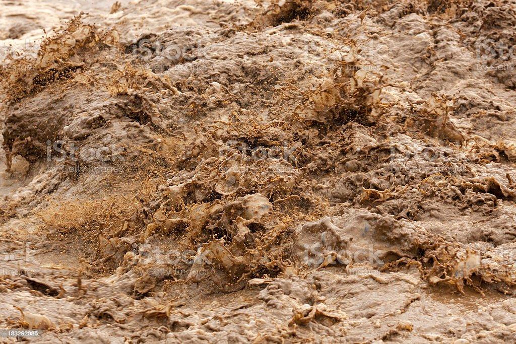 Muddy flood splashing water. stock photo