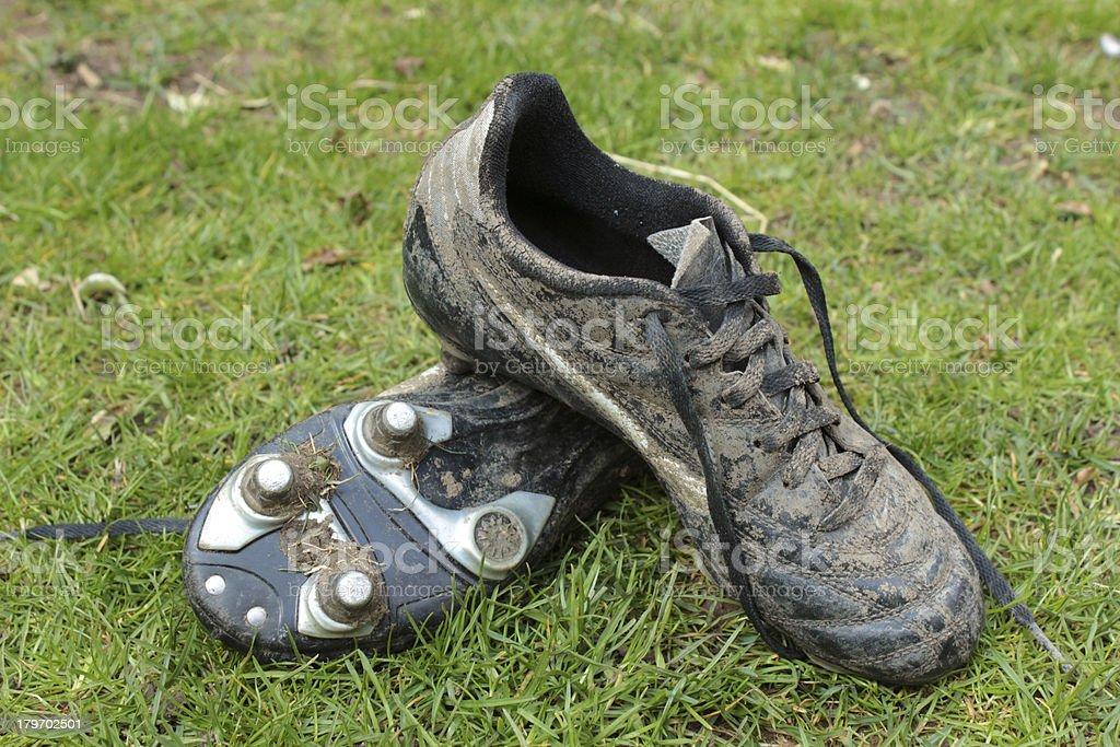 Muddy football boots stock photo