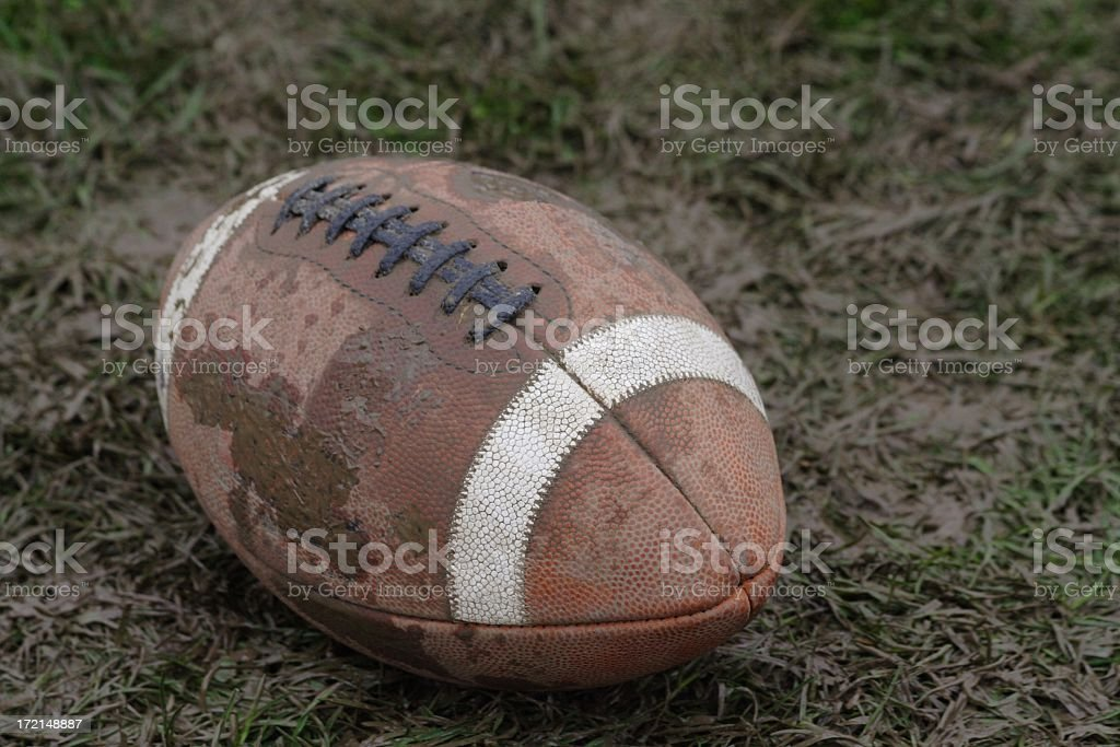 Muddy Football with Laces royalty-free stock photo