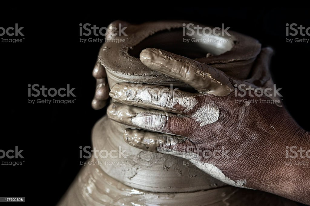 Muddy Hands of Pottery Craftsman Making Terracotta stock photo
