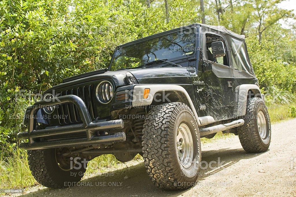Muddy Jeep Wrangler stock photo