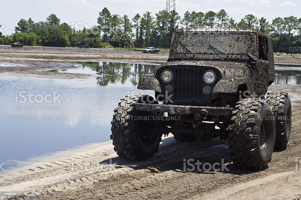 Muddy Jeep Wrangler stock photo