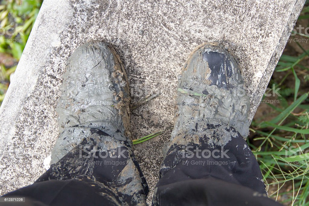 muddy leather shoes stock photo