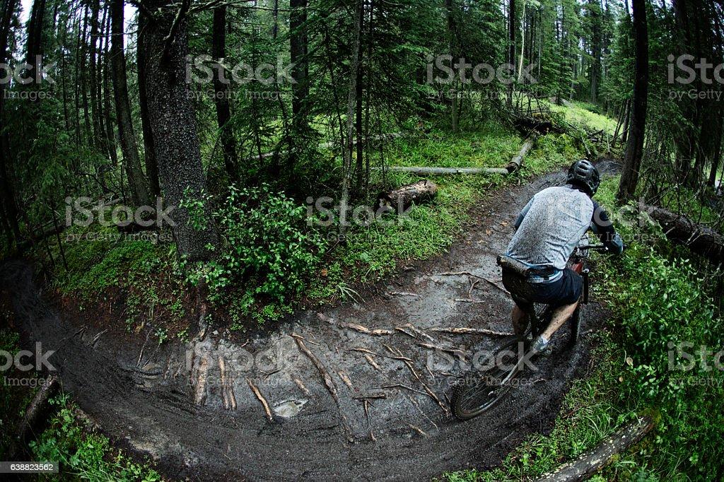 Muddy Mountain Bike Racer stock photo