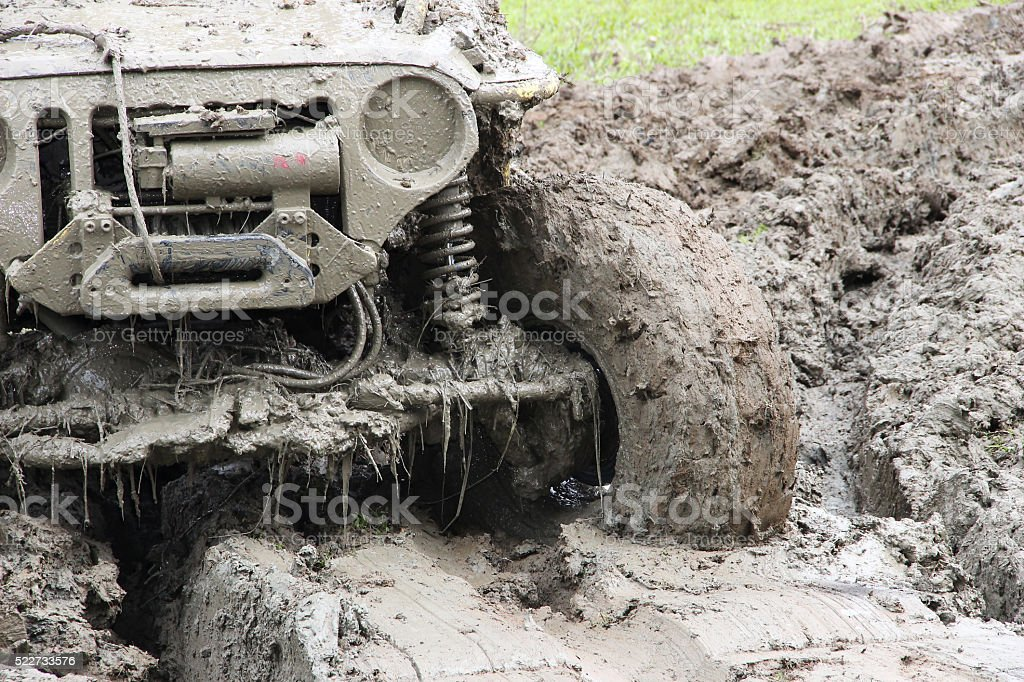 Muddy Off-road vehicle driving through mud on 4x4 Offroad race stock photo
