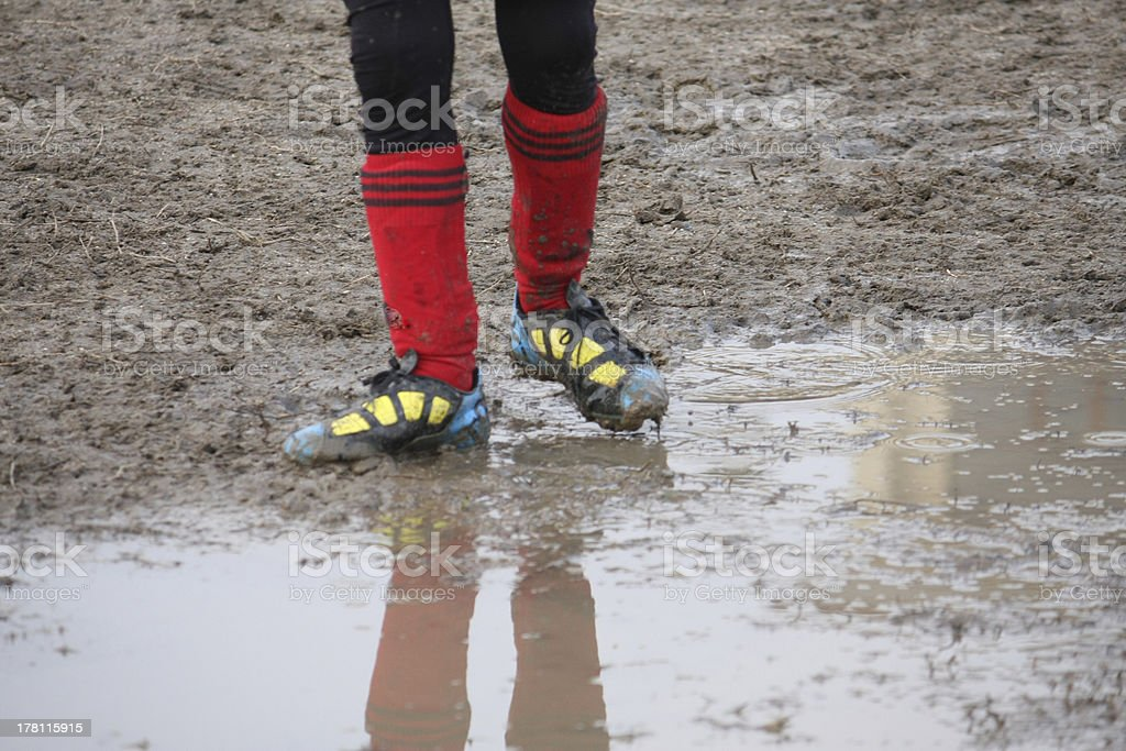 muddy shoes of a child player stock photo
