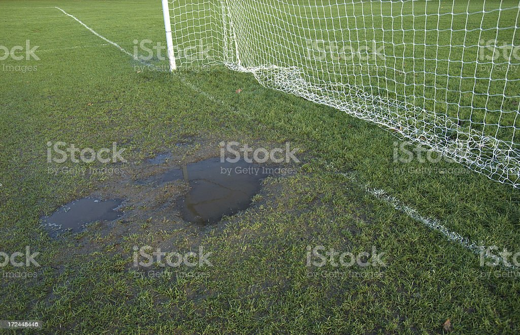 Muddy soccer pitch royalty-free stock photo
