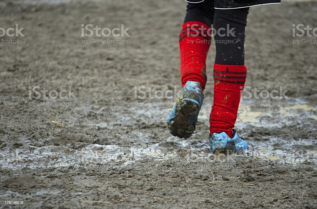 muddy soccer shoes of a child stock photo