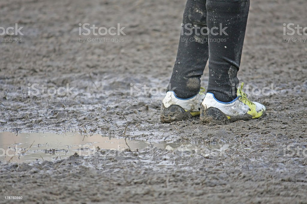 muddy soccer shoes of a child player stock photo