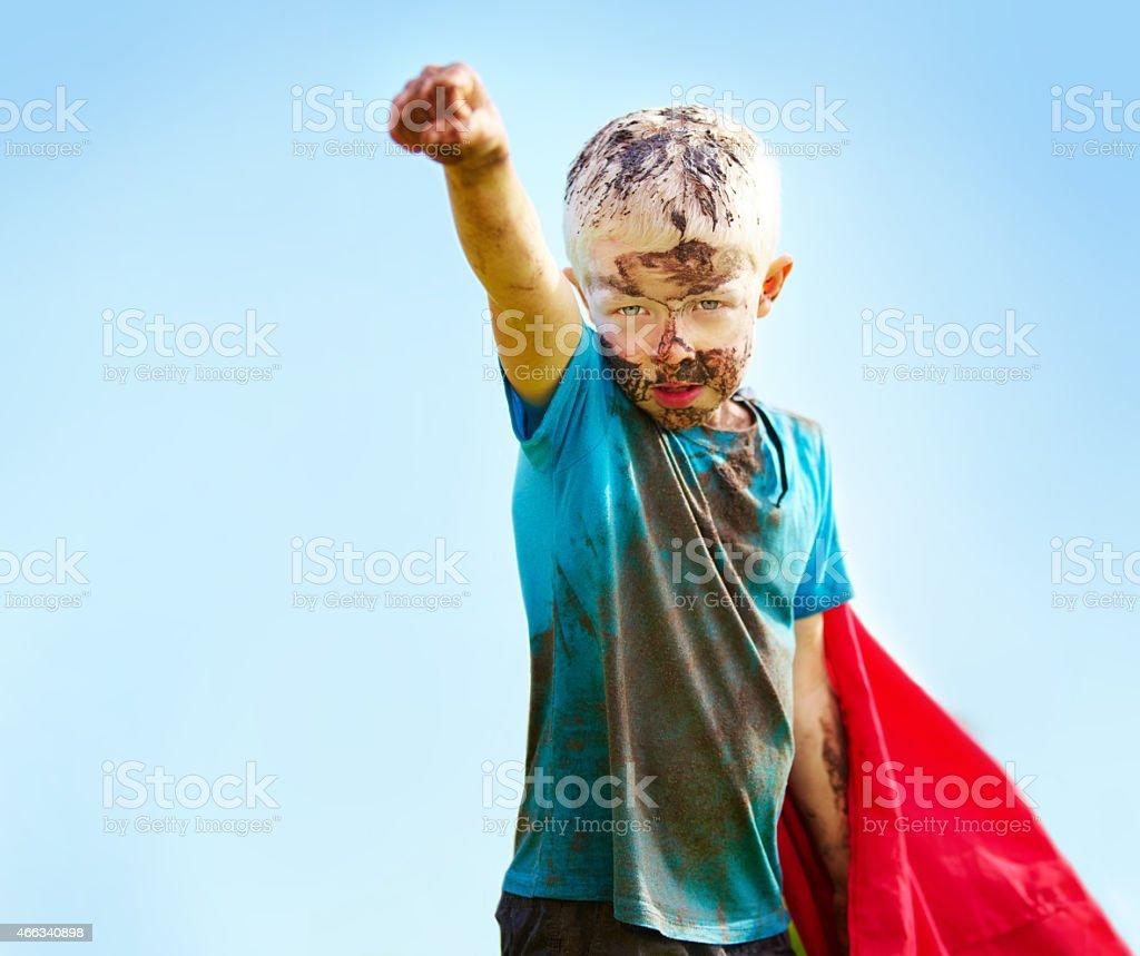 A muddy superhero stock photo