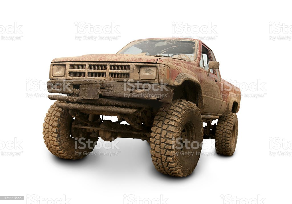 A lifted pickup truck covered with mud. Clipping path on vehicle. All...