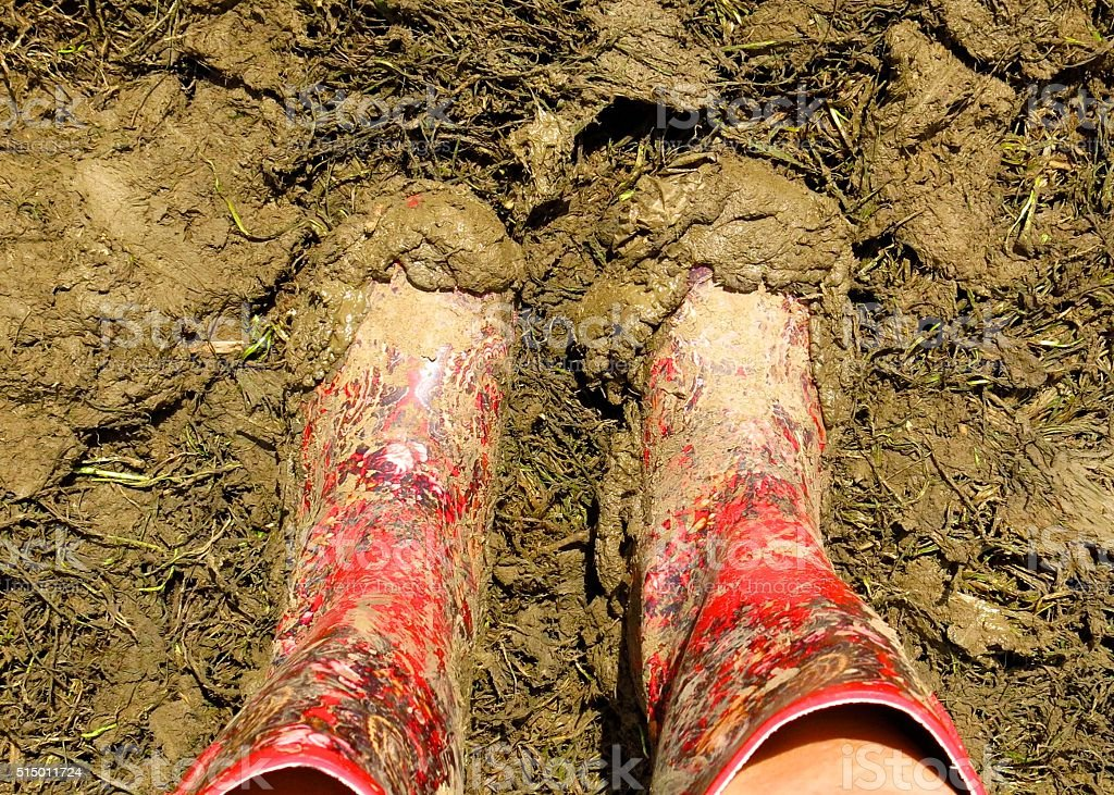 muddy wellies Wellington Boots at a music festival stock photo
