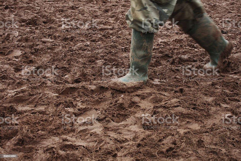Muddy Wellington boots stock photo