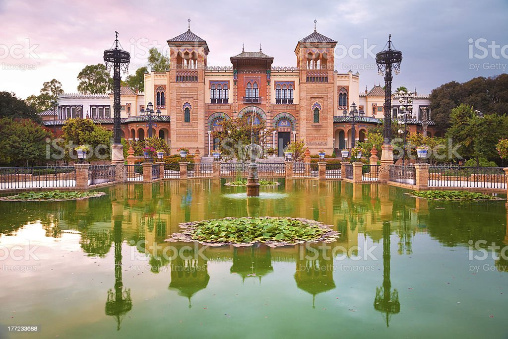 Mudejar Pavilion and pond at sunset. Sevilla royalty-free stock photo