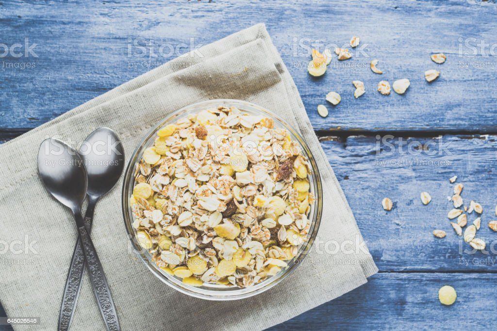 Muesli and crumbs on a dark blue background stock photo