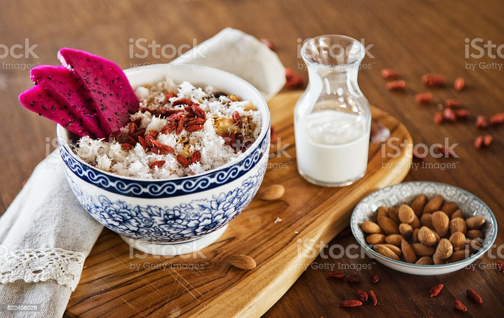Muesli served with dragon fruit, almonds, goji berries and coconut stock photo