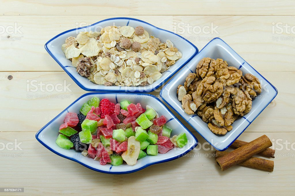 Muesli, walnuts and dried fruit on a table royalty-free stock photo