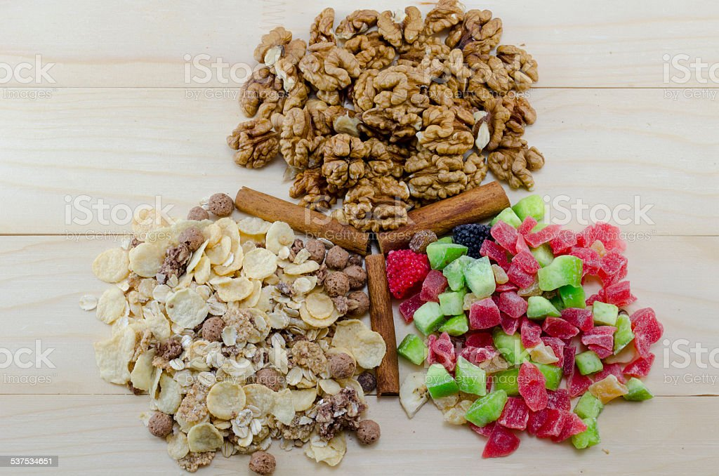 Muesli, walnuts and dried fruit on arranged a table royalty-free stock photo