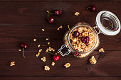 muesli with sweet cherry in the jar, flat lay