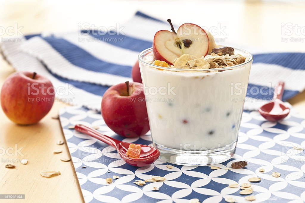 Muesli with yoghurt and apples stock photo