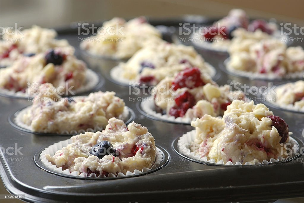 Muffin cups with dough royalty-free stock photo