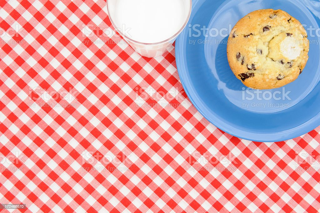 Muffin on Blue Plate With Milk, Red Checkered Tablecloth royalty-free stock photo