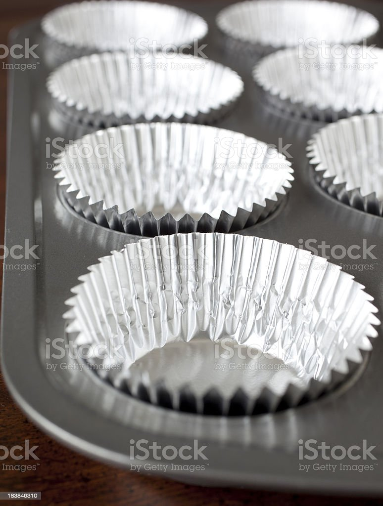 Muffin Tin with Foil Baking Cups stock photo