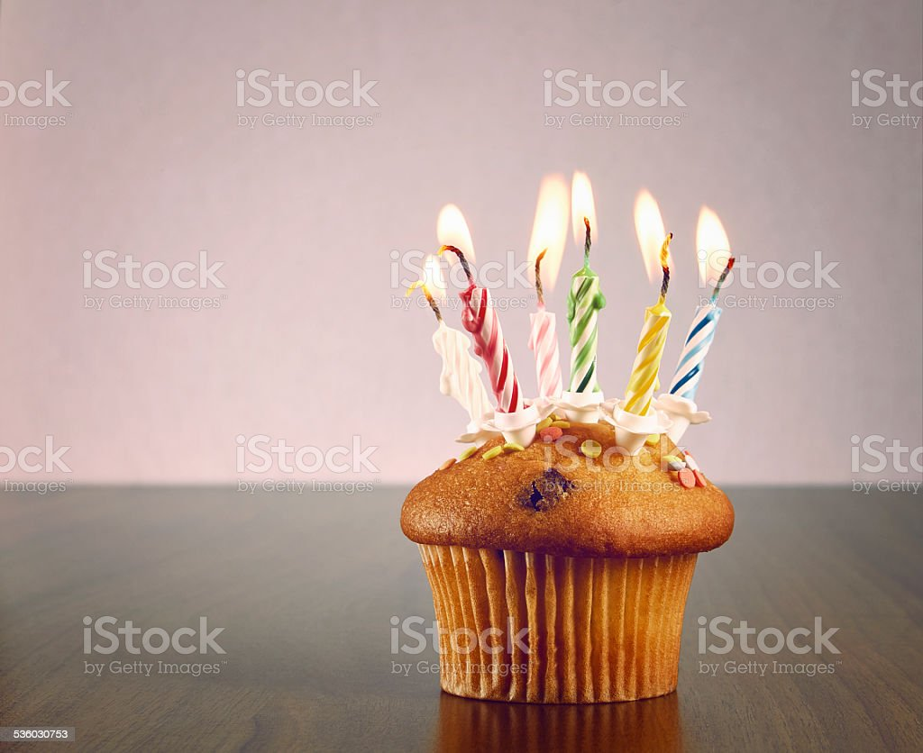 Muffin with candles stock photo