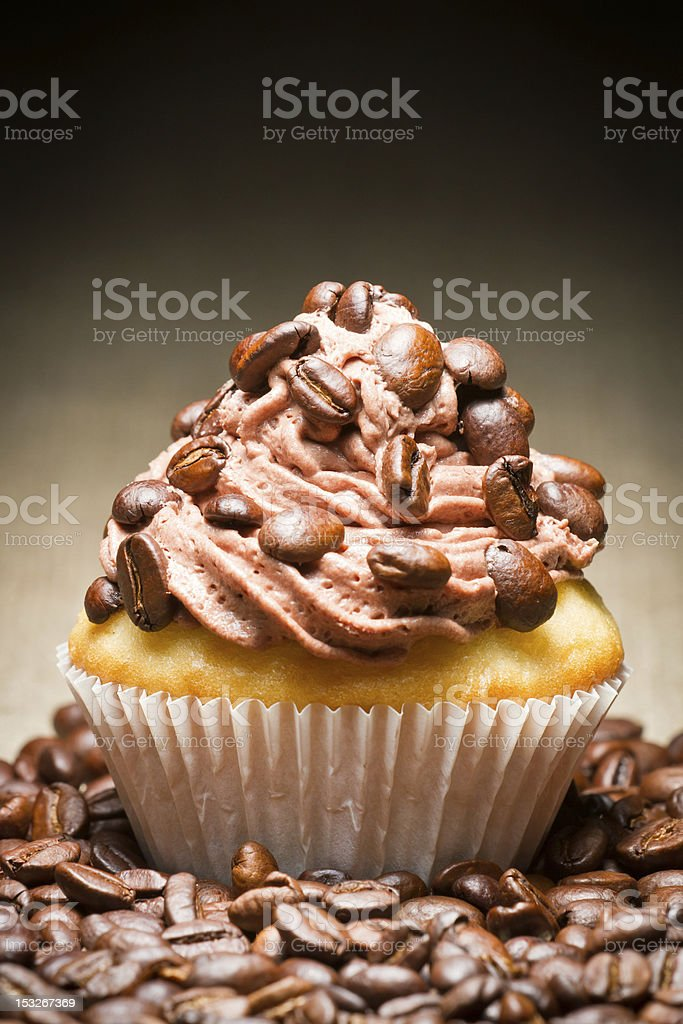 Muffin with chocolate cream and coffee beans royalty-free stock photo