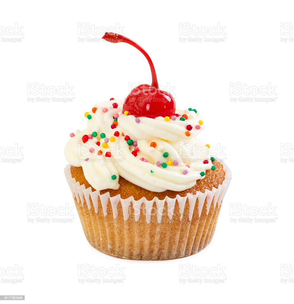Muffin with cream and maraschino cherry, decorated with colorful stock photo