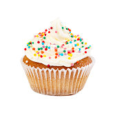 Muffin with cream, decorated colorful candy sprinkles