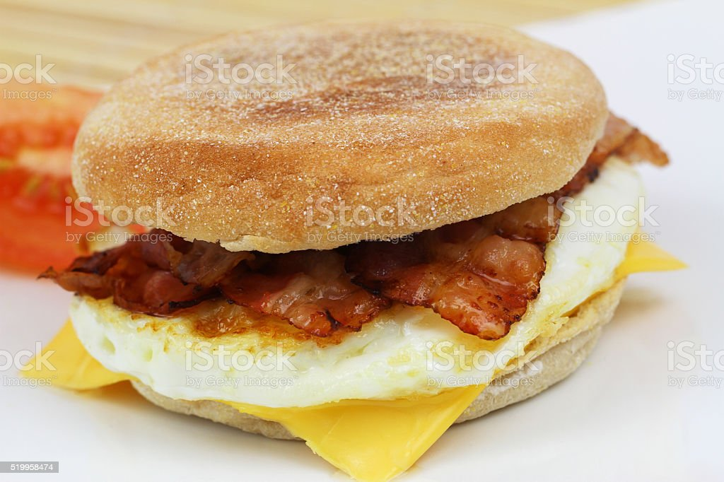 Muffin with fried egg and bacon, closeup stock photo
