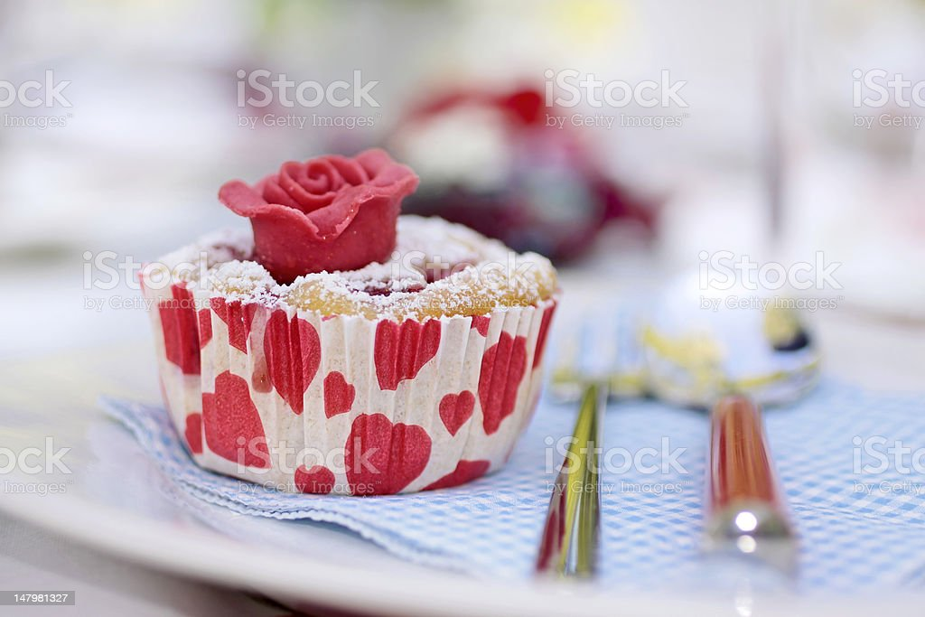 Muffin with marchpane rose stock photo
