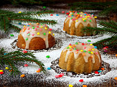 muffins decorated fondant, multicolored sprinkles. Christmas and New Year cakes