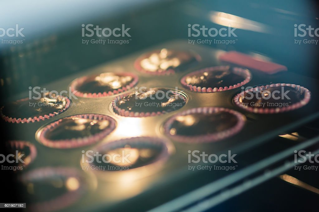 Muffins in oven stock photo